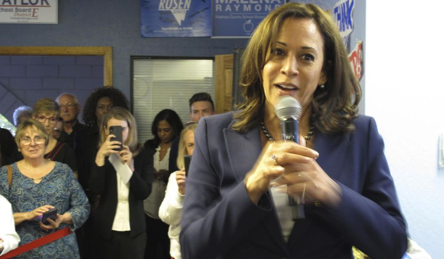 California Sen. Kamala Harris speaks to more than 100 people who jammed the Washoe County Democratic headquarters in Reno, Nev., Tuesday, April 2, 2019 for her fist presidential campaign stop in northern Nevada. Harris is bringing her Democratic presidential campaign to northern Nevada for the first time to visit party faithful and teachers and speak at a fundraiser for one of the biggest progressive groups in the early caucus state. (AP Photo/Scott Sonner)