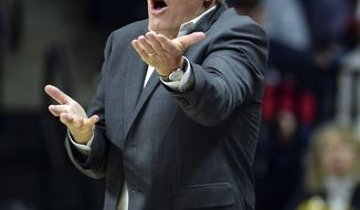 FILE - In this Nov. 11, 2018, file photo, Connecticut head coach Geno Auriemma has words for the referee in the second half of a women's NCAA college basketball game against Ohio State, in Storrs, Conn. UConn will face Notre Dame in a Final Four semifinal on Friday, April 5, 2019. (AP Photo/Stephen Dunn, File)