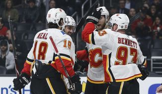 Calgary Flames forward Sam Bennett (93) celebrates his goal with teammates during the first period of an NHL hockey game against Los Angeles Kings, Monday, April 1, 2019, in Los Angeles. (AP Photo/Ringo H.W. Chiu)