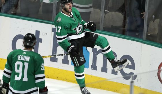 Dallas Stars right wing Alexander Radulov (47) reacts with teammate Tyler Seguin (91) looking on after Radulov scored a goal during the second period of an NHL hockey game against the Philadelphia Flyers in Dallas, Tuesday, April 2, 2019. (AP Photo/LM Otero)
