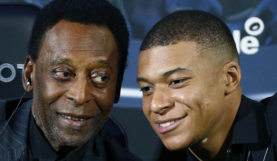 Brazilian soccer legend Pele, left, and French soccer player Kylian Mbappe pose during a photocall in Paris, Tuesday, April 2, 2019. (AP Photo)