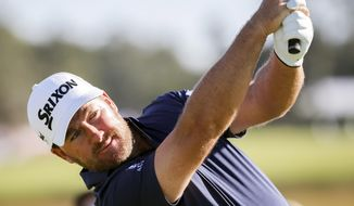 "File-This Nov. 1, 2018, file photo shows Graeme McDowell, of Northern Ireland, watching his drive off the 12th tee during the third round of the RSM Classic golf tournament in St. Simons Island, Ga. ""Getting my playing privileges was a huge goal this year. It's a goal I've never had before,"" McDowell said. ""When you're in the top 50 in the world and you're playing WGCs and majors, it's amazing how the points and money toward your playing privileges just kind of come automatically. But all of a sudden when you're grinding, when you're asking for invites like I've been doing this year, I felt like I had this monkey on my back that I couldn't shake off."" (AP Photo/Stephen B. Morton, File)"