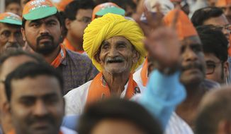 An elderly supporter of ruling Bharatiya Janata Party (BJP) smiles a he attends an election campaign rally addressed by Indian Prime Minister Narendra Modi in Hyderabad, India, Monday, April 1, 2019. India's general elections will be held in seven phases starting April 11. (AP Photo/Mahesh Kumar A.)