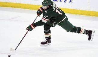 Minnesota Wild's Marcus Foligno (17) shoots the puck against the Winnipeg Jets during the third period of an NHL hockey game, Tuesday, April 2, 2019, in St. Paul, Minn. Foligno scored a goal on the play. The Wild won 5-1. (AP Photo/Hannah Foslien)