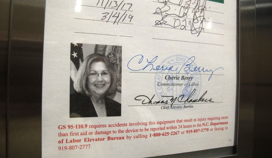 A photo of state Labor Commissioner Cherie Berry is displayed on an elevator inspection certificate in Raleigh, N.C., on Tuesday, April 2, 2019. Berry, who was sworn in as North Carolina's first female labor commissioner in January 2001, announced Tuesday that she would not seek re-election when her term ends next year. (AP Photo/Allen G. Breed)