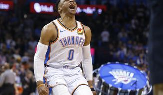 Oklahoma City Thunder guard Russell Westbrook (0) runs out and roars to the crowd before an NBA basketball game against the Los Angeles Lakers Tuesday, April 2, 2019, in Oklahoma City. (AP Photo/Sue Ogrocki)
