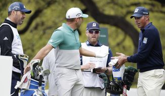 Sergio Garcia, second from left and Matt Kuchar, right, discuss on the eighth hole what had happened on the seventh green, during the Dell Technologies Match Play Championship golf tournament, Saturday, March 30, 2019, in Austin, Texas. Garcia had an 8-foot putt to win the seventh hole and left it 4 inches short, a frustrating miss. Worse yet was what followed. Such a tap-in typically is conceded in the Dell Technologies Match Play, and the Spaniard walked up and casually rapped it left-handed. The ball spun around the cup, and he picked it up and walked off the green, assuming he remained 1 down through seven holes. One problem: Matt Kuchar never formally conceded the putt. (AP Photo/Eric Gay)