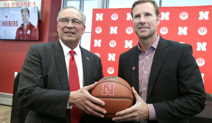Fred Hoiberg, right, poses for a photo with Athletic Director Bill Moos, after he was introduced as Nebraska's new NCAA college basketball head coach at a news conference in Lincoln, Neb., Tuesday, April 2, 2019. Hoiberg, former head coach for the Chicago Bulls and Iowa State, replaces fired head coach Tim Miles. (AP Photo/Nati Harnik)
