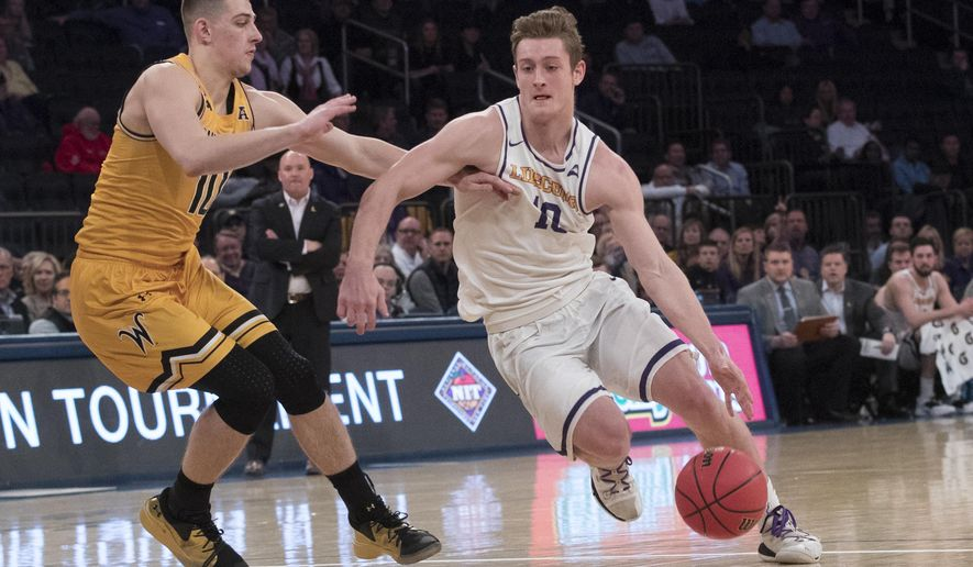 Lipscomb guard Jake Wolfe, right, drives to the basket against Wichita State guard Erik Stevenson during the first half of a semifinal college basketball game in the National Invitational Tournament, Tuesday, April 2, 2019, at Madison Square Garden in New York. (AP Photo/Mary Altaffer)