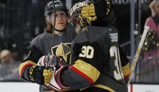 Vegas Golden Knights center Cody Eakin, left, embraces Vegas Golden Knights goaltender Malcolm Subban after their team defeated the Edmonton Oilers in an NHL hockey game Monday, April 1, 2019, in Las Vegas. (AP Photo/John Locher)