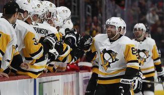 Pittsburgh Penguins right wing Phil Kessel greets teammates after scoring during the first period of an NHL hockey game against the Detroit Red Wings, Tuesday, April 2, 2019, in Detroit. (AP Photo/Carlos Osorio)