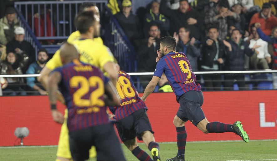 4e7d37d9a90 Barcelona forward Luis Suarez celebrates after scoring his side's fourth  goal during the Spanish La Liga
