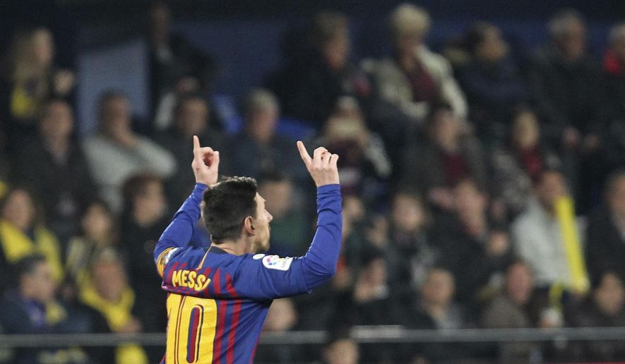 Barcelona forward Lionel Messi celebrates after scoring his side's third goal during the Spanish La Liga soccer match between Villarreal and FC Barcelona at the Ceramica stadium in Villarreal, Spain, Tuesday, April 2, 2019.(AP Photo/Alberto Saiz)