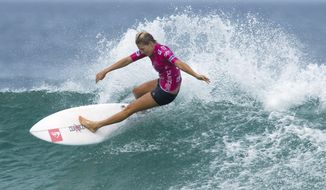 FILE - In this May 12, 2012, file photo, Australia's Stephanie Gilmore competes in the Association of Surfing Professionals, ASP, Billabong Rio Pro women's surfing competition at Barra da Tijuca beach in Rio de Janeiro, Brazil. Qualifying for the inaugural Olympic surfing competition at Tokyo 2020 has begun at Australia's Gold Coast with a World Surf League event where seven-time world champion Gilmore leads the women's field. Defending Gold Coast champion and fellow Australian Julian Wilson feature in a strong men's field that includes American great and 11-time world champion Kelly Slater and reigning series champion Gabriel Medina. (AP Photo/Felipe Dana, File)
