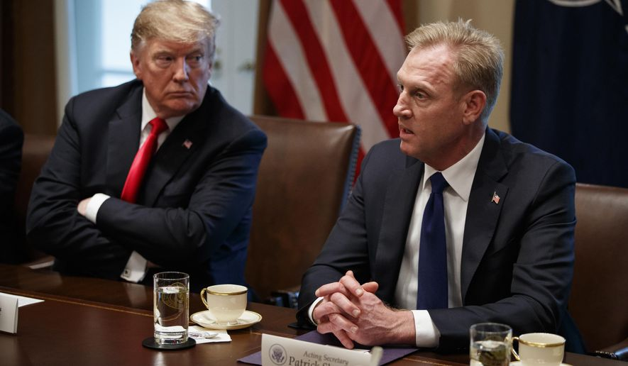 President Donald Trump listens as acting Secretary of Defense Patrick Shanahan speaks during an expanded bilateral meeting with NATO Secretary General Jens Stoltenberg in the Cabinet Room of the White House, Tuesday, April 2, 2019, in Washington. (AP Photo/Evan Vucci)
