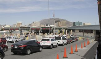 Vehicles from Mexico and the U.S. approach a border crossing in El Paso, Texas, Monday, April 1, 2019. (AP Photo/Cedar Attanasio)