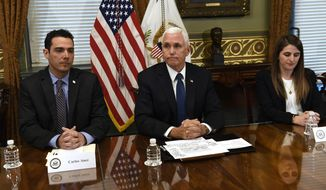 Vice President Mike Pence, center, sitting next to Carlos Anez, left, and Veronica Vadell Weggeman, right, listens during a meeting in the Vice President's Ceremonial Office on the White House complex in Washington, with family members of the six Citgo executives currently detained in Venezuela, Tuesday, April 2, 2019. (AP Photo/Susan Walsh)