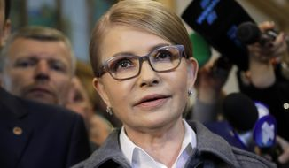 Former Ukrainian Prime Minister Yulia Tymoshenko, a candidate for the presidential elections, talks to the media after casting her ballot at a polling station during the presidential election in Kiev, Ukraine, Sunday, March 31, 2019. Ukrainians choose from among 39 candidates for a president they hope can guide the country of more than 42 million out of troubles including endemic corruption, a seemingly intractable conflict with Russia-backed separatists in the country's east and a struggling economy. (AP Photo/Sergei Grits)