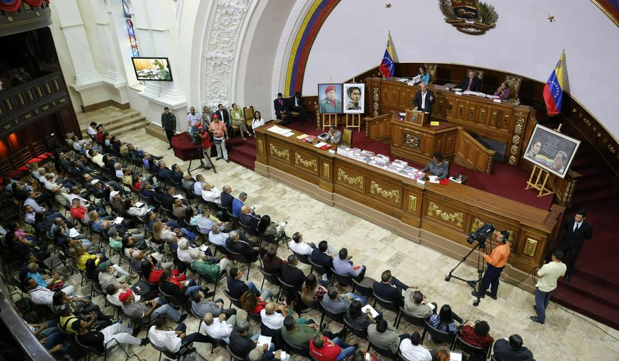 National Constituent Assembly members attend a session in Caracas, Venezuela, Tuesday, April 2, 2019. Lawmakers loyal to President Nicolas Maduro considered whether to strip National Assembly leader Juan Guaido of immunity on Tuesday in a move that would pave the way to prosecute and potentially arrest him for allegedly violating the constitution after declaring himself interim president. (AP Photo/Ariana Cubillos)