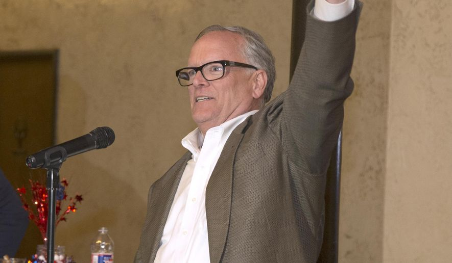 "FILE - In this March 6, 2018 file photo, McLennan County District Attorney Barry Johnson raises his hand while thanking supporters during an election party, in Waco, Texas. Johnson said in a statement Tuesday, April 2, 2019, that all charges will be dropped in the 2015 shootout between rival biker gangs in Waco restaurant parking lot that left nine people dead and at least 20 injured. Johnson said any further effort to prosecute the case would be a ""waste of time, effort and resources."" (Rod Aydelotte/Waco Tribune Herald, via AP, File)"