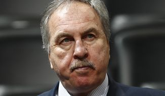 FILE - In this March 8, 2017, file photo, Washington Wizards general manager Ernie Grunfeld watches during the first half of an NBA basketball game in Denver. Grunfeld has been fired as president of the Washington Wizards after 16 seasons in charge of the team. The Wizards announced his dismissal on Tuesday, April 2, 2019,  with four games left in a disappointing, no-playoffs season.(AP Photo/David Zalubowski) ** FILE **