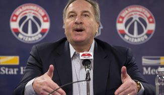 FILE - In this April 14, 2016, file photo, Washington Wizards basketball President Ernie Grunfeld speaks during a news conference at the Verizon Center in Washington. Grunfeld has been fired as president of the Washington Wizards after 16 seasons in charge of the team. The Wizards announced his dismissal on Tuesday, April 2, 2019,  with four games left in a disappointing, no-playoffs season. (AP Photo/Pablo Martinez Monsivais, File)