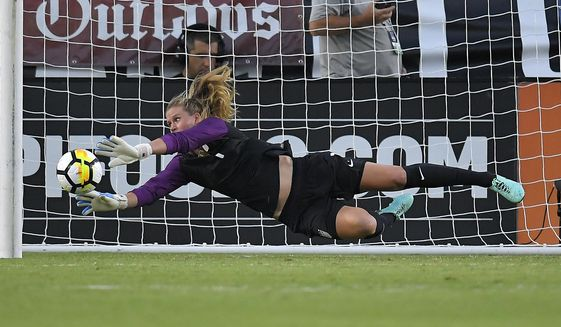 FILE - In this Aug. 3, 2017, file photo, U.S. goalkeeper Alyssa Naeher stops a shot against Japan during the first half of a Tournament of Nations soccer match, in Carson, Calif. Naeher recalls that as a freshman in college a teammate told her she couldn't afford to be intimidated. The U.S. national team goalkeeper carries that advice as she prepares for the World Cup. (AP Photo/Mark J. Terrill, File)