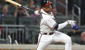 Atlanta Braves' Johan Camargo watches a three-run double against the Chicago Cubs during the eighth inning of a baseball game Wednesday, April 3, 2019, in Atlanta. (Curtis Compton/Atlanta Journal-Constitution via AP)