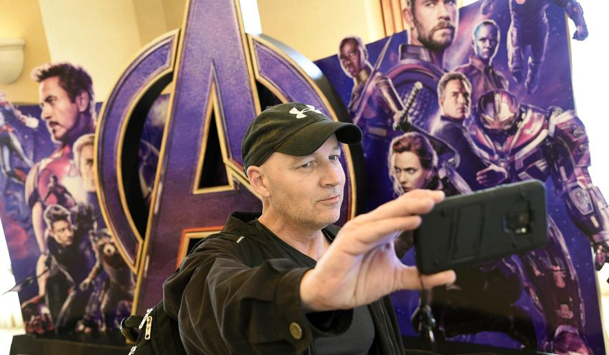 "CinemaCon attendee Luis Saint Amant, of Argentina, takes a selfie in front of an advertisement for the upcoming film ""Avengers: Endgame,"" on the first day of CinemaCon 2019, the official convention of the National Association of Theatre Owners (NATO) at Caesars Palace, Monday, April 1, 2019, in Las Vegas. (Photo by Chris Pizzello/Invision/AP)"