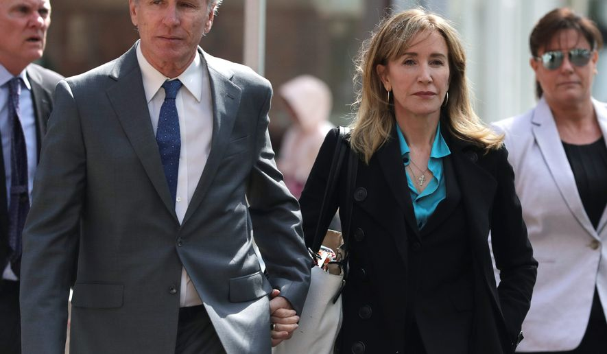 """""""Desperate Housewives"""" actress Felicity Huffman, pictured here with her brother Moore Huffman Jr. (left), has been charged with dozens of other parents in a college admissions bribery scandal."""