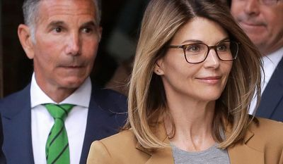 """Full House"" actress Lori Loughlin, (front), and husband, clothing designer Mossimo Giannulli, (left), depart federal court in Boston on Wednesday after facing charges in a nationwide college admissions bribery scandal."