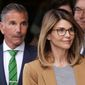 """""""Full House"""" actress Lori Loughlin, (front), and husband, clothing designer Mossimo Giannulli, (left), depart federal court in Boston on Wednesday after facing charges in a nationwide college admissions bribery scandal."""