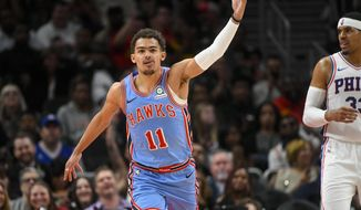 Atlanta Hawks guard Trae Young reacts after scoring on the Philadelphia 76ers during the second half of an NBA basketball game Wednesday, April 3, 2019, in Atlanta. The Hawks won 130-122. (AP Photo/John Amis)