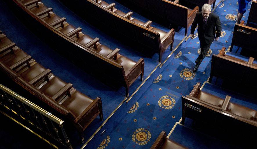 Senate Majority Leader Mitch McConnell of Ky., walks off the House floor following a speech by NATO Secretary General Jens Stoltenberg at a Joint Meeting of Congress on Capitol Hill in Washington, Wednesday, April 3, 2019, having been invited by the bipartisan leadership of the House of Representatives and the Senate. (AP Photo/Andrew Harnik)