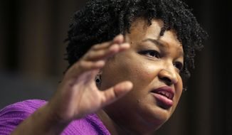 Former Georgia gubernatorial candidate Stacey Abrams speaks during the National Action Network Convention in New York, Wednesday, April 3, 2019. (AP Photo/Seth Wenig) ** FILE **