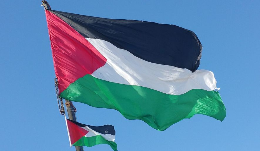 Two Palestinian flags flying. (Wikipedia)