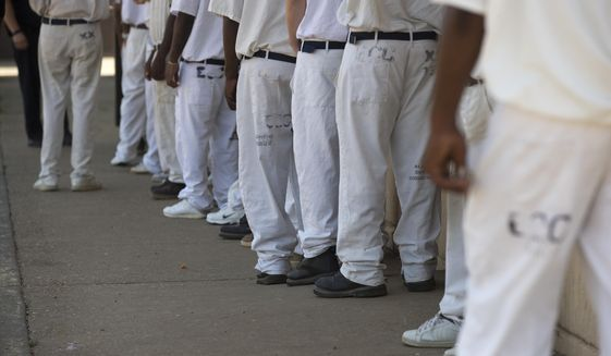 "FILE- In this June 18, 2015 file photo, prisoners stand in a crowded lunch line during a prison tour at Elmore Correctional Facility in Elmore, Ala. he Justice Department has determined that Alabama's prisons are violating the Constitution by failing to protect inmates from violence and sexual abuse and by housing them in unsafe and overcrowded facilities, according to a scathing report Wednesda, April 3, 2019, that described the problems as ""severe"" and ""systemic."". (AP Photo/Brynn Anderson)"