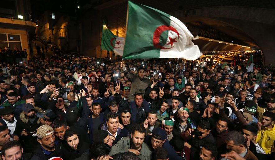 "A crowd celebrates after ailing Algerian President Abdelaziz Bouteflika resigned after 20 years in power, Tuesday April 2, 2019 in Algiers. Bouteflika quit in a statement read on national television after the country's Defense Ministry aggressively called for Bouteflika to ""immediately"" vacate the office he held for two decades. (AP Photo/Toufik Doudou)"