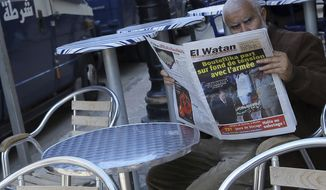 A man reads a newspaper headlining Algerian President Abdelaziz Bouteflika's resignation, Wednesday April 3, 2019 in Algiers. Algeria's Constitutional Council met Wednesday to confirm President Abdelaziz Bouteflika's resignation, as rattled international partners watch closely to see what's next for this gas-rich country and key player in the global fight against terrorism. (AP Photo/Anis Belghoul)