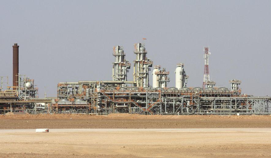 FILE - This Dec. 14, 2008 file photo shows the Krechba gas plant in Algeria's Sahara Desert, about 1,200 kilometers (720 miles) south of the capital, Algiers. Algeria's Constitutional Council met on Wednesday, April 3, 2019, to confirm President Abdelaziz Bouteflika's resignation as the country's political shake-up raises questions about the energy industry. (AP Photo/Alfred de Montesquiou, File)