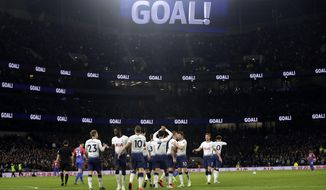 Tottenham players celebrate after Christian Eriksen scored their side's second goal during the English Premier League soccer match betweenTottenham Hotspur and Crystal Palace, the first Premiership match at the new Tottenham Hotspur stadium in London, Wednesday, April 3, 2019. (AP Photo/Kirsty Wigglesworth)