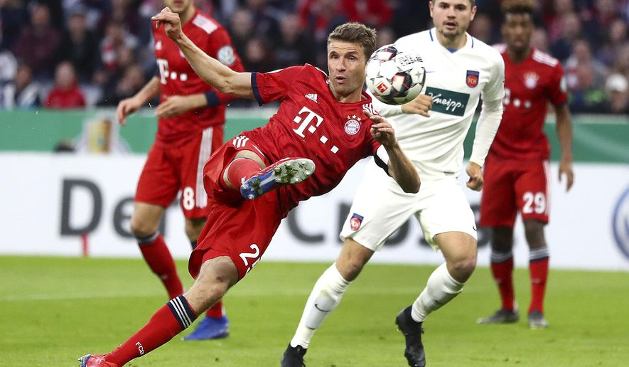 Munich's Thomas Mueller scores his side's equalizing goal during the German Soccer Cup match between FC Bayern Munich and 1. FC Heidenheim in Munich, Germany, Wednesday, April 3, 2019. (AP Photo/Matthias Schrader)