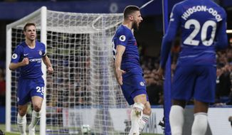 Chelsea's Olivier Giroud, center, celebrates with teammates Cesar Azpilicueta, left, and Callum Hudson-Odoi, right, after scoring his sides first goal during the English Premier League soccer match between Chelsea and Brighton & Hove Albion at Stamford Bridge stadium in London, Wednesday, April 3, 2019. (AP Photo/Frank Augstein)