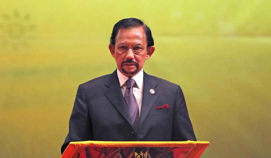 In this Oct, 10, 2013, file photo, Brunei's Sultan Hassanal Bolkiah speaks during the closing ceremony and handover of the ASEAN Chairmanship to Myanmar in Bandar Seri Begawan. The sultan announced to implement Islamic criminal laws that punishes gay sex by stoning offenders to death. The legal change in the tiny, oil-rich monarchy, which also includes amputation for theft, is due to come into force Wednesday, April 3, 2019. (AP Photo/Vincent Thian)