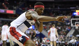 Washington Wizards guard Bradley Beal (3) gestures after he made a three-point basket during the first half of an NBA basketball game against the Chicago Bulls, Wednesday, April 3, 2019, in Washington. (AP Photo/Nick Wass) ** FILE **
