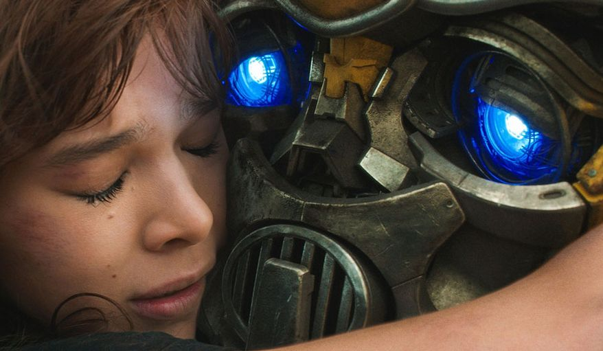 "Charlie Wilson (Hailee Steinfeld)  hugs her new best friend in ""Bumblebee,"" now available on 4K Ultra HD from Paramount Pictures Home Entertainment."