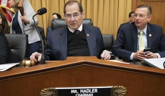 House Judiciary Committee Chair Jerrold Nadler, D-N.Y., joined at right by Ranking Member Doug Collins, R-Ga., prepares for the start of a hearing on The Equality Act, a comprehensive nondiscrimination bill for LGBT rights, on Capitol Hill in Washington, Tuesday, April 2, 2019. Nadler is preparing subpoenas seeking special counsel Robert Mueller's full Russia report as the Justice Department appears likely to miss an April 2 deadline set by Democrats for the report's release. (AP Photo/J. Scott Applewhite)