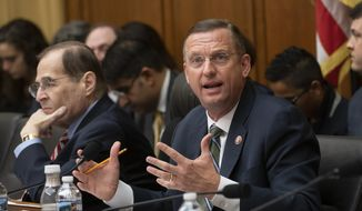 House Judiciary Committee Ranking Member Doug Collins, R-Ga., makes an objection to the resolution by Chairman Jerrold Nadler, D-N.Y., left, to subpoena special counsel Robert Mueller's full report, on Capitol Hill in Washington, Wednesday, April 3, 2019. (AP Photo/J. Scott Applewhite) ** FILE **