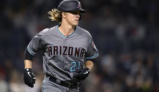 Arizona Diamondbacks' Zack Greinke runs the bases after hitting a home run during the sixth inning of a baseball game against the San Diego Padres, Tuesday, April 2, 2019, in San Diego. (AP Photo/Orlando Ramirez)