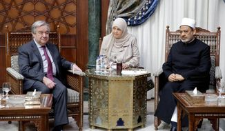 This photo released by Al Azhar, shows U.N. Secretary-General Antonio Guterres, left, during a meeting with Muslim cleric Sheikh Ahmed el-Tayeb, the grand imam, at the Al Azhar headquarters in Cairo, Egypt, Tuesday April 2, 2019. The U.N. chief has expressed solidarity with Muslims the world over during a visit to Cairo, denouncing hate speech and racism, as well as anti-Semitism. (Al Azhar via AP)